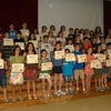 During the last full-school assembly of the 2010-11 academic year Head O' Meadow fourth grade students who passed all eight geography tests provided through the school's PTA geography program were recognized. The 41 students were tested on the eastern states and capitals, western states and capitals, United States bodies of water, mountains and Cana-dian provinces, South America and surrounding countries, continents, oceans, major seas, Europe, and Africa. More than 150 students participated in the program. Above, the students stand with Geography Program Coordinator Kristen Mattera, top left, Head O' Meadow Principal Barbara Gasparine, top far right, and Lead Teacher Jen Meyers, middle row far right.  (Hallabeck photo)