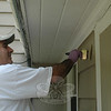 Trident employee Mustafa Turan laid a new coat of paint on an Ability Beyond Disability group home on West Street during the 2011 United Way Day of Caring on June 8.  (Voket photo)