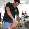 "Quinn Fontaine digs his knife into the tail of a steamed lobster. A team of volunteers is re-sponsible for cutting the tails and cracking the claws of each lobster as soon as they are pulled from the steamer.  (Hicks photo) NOTE: additional photos from LobterFest can be found in their own photo gallery, found here: <a href=""http://photos.newtownbee.com/Events/24th-Annual-Sandy-Hook-Lobster/17597124_2qVGdM#1340648801_zvgNTZN"">http://photos.newtownbee.com/Events/24th-Annual-Sandy-Hook-Lobster/17597124_2qVGdM#1340648801_zvgNTZN</a>"