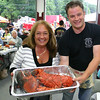 "Sandy Hook Fire & Rescue Company Engineer Rob Sibley gives a hand to Laura Piazza, who won one of two giant lobsters raffled by the fire company last weekend. Mrs Piazza won the 11-pound creature Friday night, and returned the following evening to claim her cooked crustacean. The 24th Annual Sandy Hook LobsterFest ran Friday and Saturday, June 10 and 11, at the fire company's main station.  (Hicks photo) NOTE: additional photos from LobterFest can be found in their own photo gallery, found here: <a href=""http://photos.newtownbee.com/Events/24th-Annual-Sandy-Hook-Lobster/17597124_2qVGdM#1340648801_zvgNTZN"">http://photos.newtownbee.com/Events/24th-Annual-Sandy-Hook-Lobster/17597124_2qVGdM#1340648801_zvgNTZN</a>"