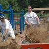 At Treadwell Park on June 8, about a dozen Newtown Savings Bank staffers including, from left, Seamus Walsh, Manny Fernandez, and Jon Rodriguez, laid down several truckloads of mulch in honor of United Way's 2011 Day of Caring.  (Voket photo)