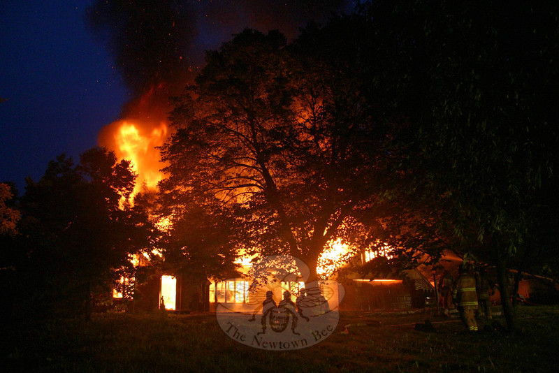 "Firefighters from all five of Newtown's fire companies responded to a structure fire at 31 Great Hill Road early in the morning of Thursday, June 23, but the fire was fully involved by the time even the first crews arrived on the scene. The house was a total loss.  (Hicks photo)<br /> PLEASE NOTE a full gallery of photos from this story is available here <br />  <a href=""http://photos.newtownbee.com/Journalism/Great-Hill-Road-structure-fire/17722752_Mww4sF#1352714583_RLsD86z"">http://photos.newtownbee.com/Journalism/Great-Hill-Road-structure-fire/17722752_Mww4sF#1352714583_RLsD86z</a>"