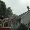 Sandy Hook volunteer firefighters used their aerial truck for ladder access to the roof of a house at 8-A Walnut Tree Hill Road where a lightning strike had caused a fire in the basement on Wednesday, June 22.  (Gorosko photo)