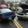 A two-car accident that occurred on Dodgingtown Road (Route 302) near Dodgingtown Market about 7:55 am Wednesday, October 27, caused traffic detours in Dodgingtown Center during the morning rush. Police, Dodgingtown volunteer firefighters, and volunteer ambulance crews responded to the accident. Police said that motorist Amy Kahan, 38, of Bethel, who was driving a 2010 Ford Mustang convertible, was attempting to exit the parking lot at 57 Dodgingtown Road and make a left turn to head northward on Dodgingtown Road, as motorist Wilson Chacho, 31, of Danbury was driving a 1995 Plymouth Neon sedan southward on Dodgingtown Road. The two vehicles collided. Ambulance staffers evaluated the people involved in the accident at the scene, but no one was transported. Police issued Kahan a written warning for failure to grant the right of way.  (Gorosko photo)