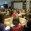 In the first of two celebrations to highlight summer readers at Middle Gate Elementary School, library/media specialist Heather LeBlanc welcomed students in first and second grade to the school's library on Tuesday, October 26, for apples and caramel sauce, and ap-ple juice or hot chocolate. Students in third and fourth grade will be recognized for their summer reading efforts on November 9.  (Hallabeck photo)