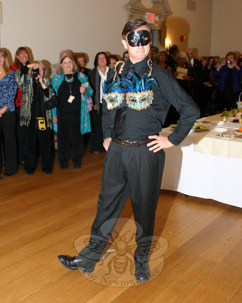 "Bob Tait proudly showed off ""Let's Take The Mystery Out of Cancer"" during the October 23 Artful Bras event.  (Hicks photo)"
