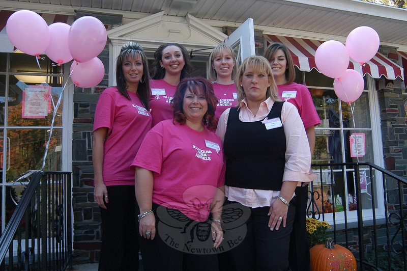 "Klickers Hair Studio owner Toni Ribeiro, front left, and UK Gourmet owner Lisa Whitmore, front right, stand with, from back left, Klickers Hair Studio ""Pink Angels"" for the day Lara Saraiva, Alexa-Rae Morin, Sarah VanWattum, and Marcia Ferreira during a fundraiser for the National Breast Cancer Foundation on Sunday, October 17.  (Hallabeck photo)"
