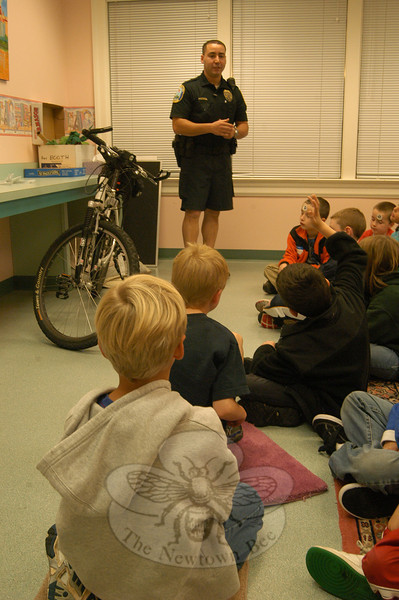 Sandy Hook Elementary School second graders learned bicycle safety tips from Officer Leonard Penna on Thursday, October 21, at C.H. Booth Library.   (Hallabeck photo)