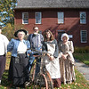From left, Jim Spillane, Jackie Spillane, Dave Pooler, Vanessa Villamil, and Shirley Paproski stand outside the Matthew Curtiss house on Sunday, October 17, to welcome visitors to the Newtown Historical Society's open house. Visitors received tours through the house by volunteers, and Mr Pooler, a member of the Connecticut Division of The Wheelmen, shared information about antique bicycles on the front lawn of the Main Street property.  (Hallabeck photo)