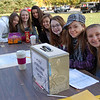 Newtown Middle School eighth graders, from left, Bailey Smith, Caroline Stolfi, Emily Crebbin, Kaitlyn Zimmerman, Caitlin Jones, Rebecca Oberstadt, and Jackie Mooney oversaw ballot entries for the NMS 2010 Scarecrow Contest on Saturday, October 23.  (Hallabeck photo)
