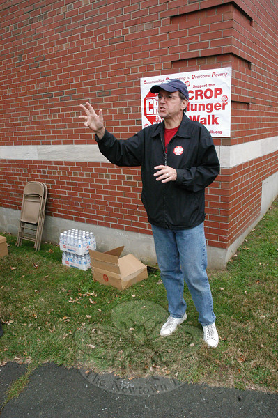 Pastor Greg Wismar of Christ The King Lutheran Church spoke to those assembled near Cochran House at Fairfield Hills before the CROP Walk  started.   (Gorosko photo)