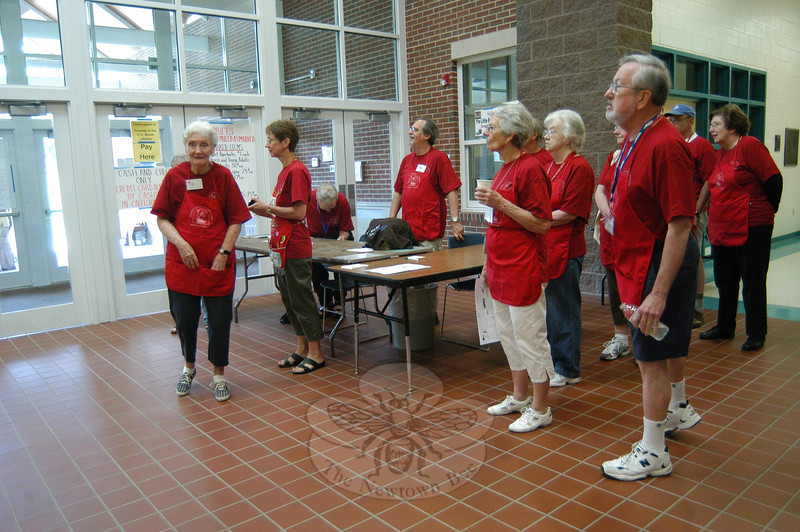 Volunteers gathered in the lobby of Reed School just prior to the opening of the 2011 Friends of Booth Library Book Sale on July 9.  (Hallabeck photo)