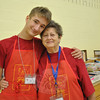 Adam Kocurek and his grandmother Nancy Steiner come from Shelton every summer to volunteer at the Friends of the C.H. Booth Library Annual Book Sale. Along with two weeks of special time together, the two book lovers get to mingle with other likeminded volunteers in an organized and exciting atmosphere, they say.  (Crevier photo)