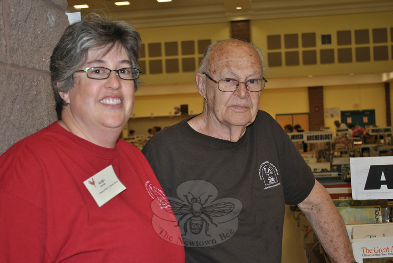 """Living in California is not enough to keep Kelley Johnson, left, away from volunteering every year at the book sale in her former hometown, with father Ken Johnson. """"It's our thing,"""" she says, plus she always meets up with people from her childhood while working the sale.  (Crevier photo)"""