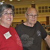 "Living in California is not enough to keep Kelley Johnson, left, away from volunteering every year at the book sale in her former hometown, with father Ken Johnson. ""It's our thing,"" she says, plus she always meets up with people from her childhood while working the sale.  (Crevier photo)"