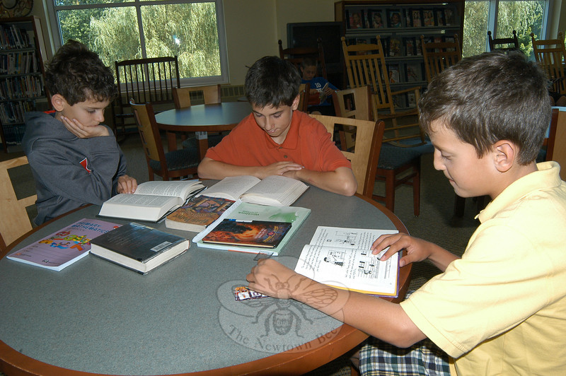 From left, Michael Arther, Kevin Arther, Robert Disibio, background, and James Doyle read on Monday, July 11, during this summer's Accelerated Reader program at Reed.  (Hallabeck photo)