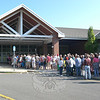 Collectors and book bargain hunters formed a long line outside the Reed School, waiting for the doors to open on the first day of the 2011 Friends of C.H. Booth Library Book Sale on July 9.  (Hallabeck photo)
