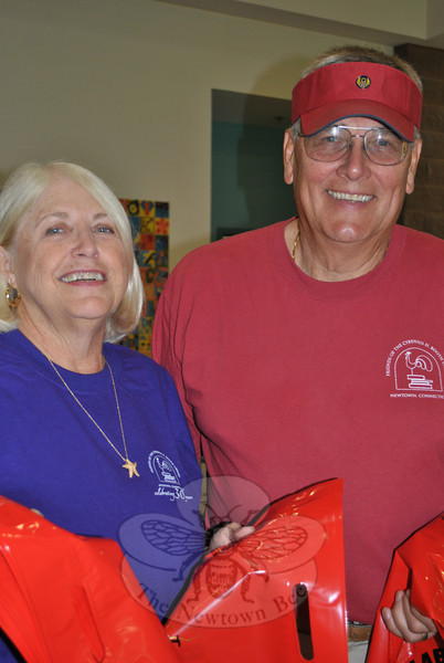 "Kaaren and Jerry Valenta continue to summer in Woodbury, after moving to Florida five years ago from Sandy Hook. They always make sure to set aside the Tuesday of the annual book sale, known as ""Bag Day,"" to volunteer — and reconnect with all of the Newtowners that they know.  (Crevier photo)"