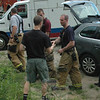 Hook & Ladder Fire Chief Jason Rivera shakes the hand of a man whose wife had successfully given birth to the couple's second son shortly after 6 pm on July 13. Emergency personnel responded to make sure all went well for the mother and child, who were doing well and transported to Danbury Hospital following the delivery.  (Gorosko photo)