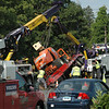 Workers used two large wreckers to right a trailer, and the aerial lift that the trailer was carrying, after the vehicles toppled over while being towed on Church Hill Road on the afternoon of Thursday, July 7. There were no injuries in the incident, which caused travel delays during the afternoon rush as workers put the trailer back on its wheels.  (Gorosko photo)