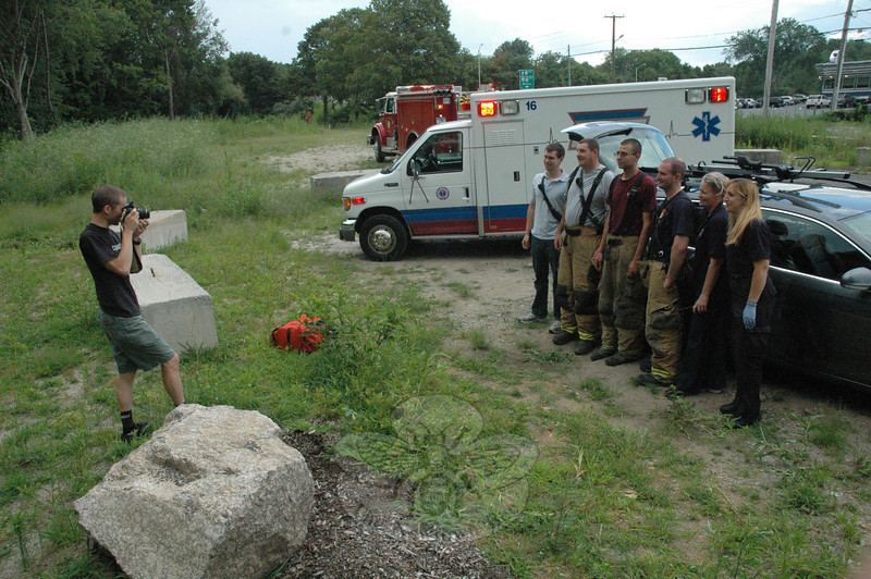Danbury Ambulance personnel, Hook & Ladder firefighters, and Newtown Volunteer Ambulance Corps members stood for a photo taken by the proud father of a young, seemingly healthy boy born a little earlier than expected on July 13. A young couple from Woodbury had been en route to a birthing center in Danbury early Wednesday evening when the childbirth happened in the family car, which had been hastily parked along Church Hill Road.  (Gorosko photo)