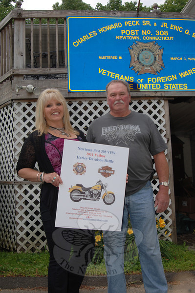 Nancy Crofoot and Bill Farley hold up a picture of a Fat Boy Harley-Davidson Motorcycle that the Veterans of Foreign Wars Post 308 is raffling. Two hundred-fifty tickets are for sale at the VFW Post for $100 apiece. The raffle drawing and party will be at the VFW post on November 11 starting at 2 pm. Contact post308newtown@yahoo.com with questions.