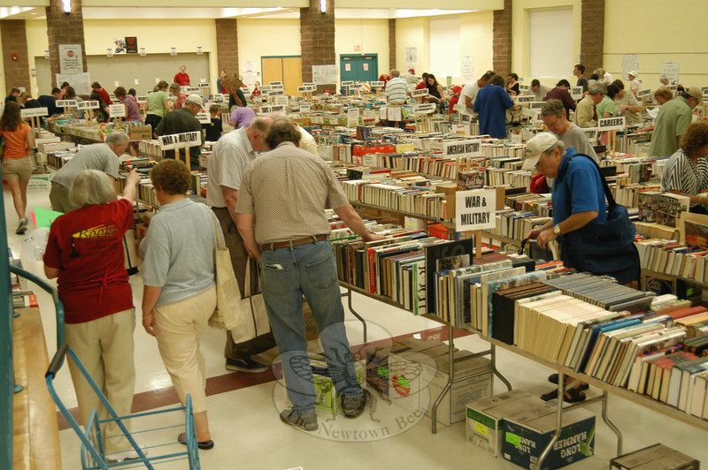 The cafetorium at the Reed School was filled with books in scores of categories, providing the incentive for book lovers to browse for hours.  (Hallabeck photo)
