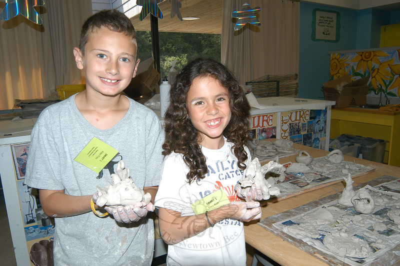 Aiden Foss, left, and Eliza Roth hold clay creations made in The Great Clay Adventure program.  (Hallabeck photo)
