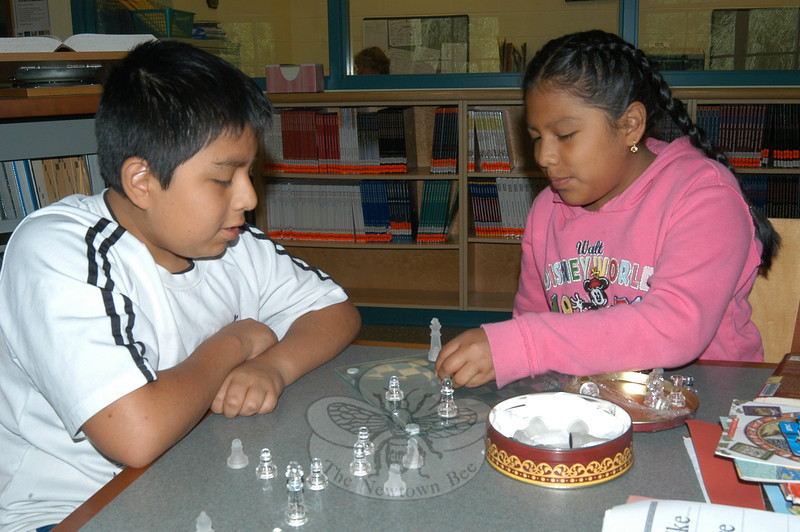 Brother and sister John and Heidi Alvarez play chess on Monday, during this summer's Accelerated Reader program at Reed.  (Hallabeck photo)