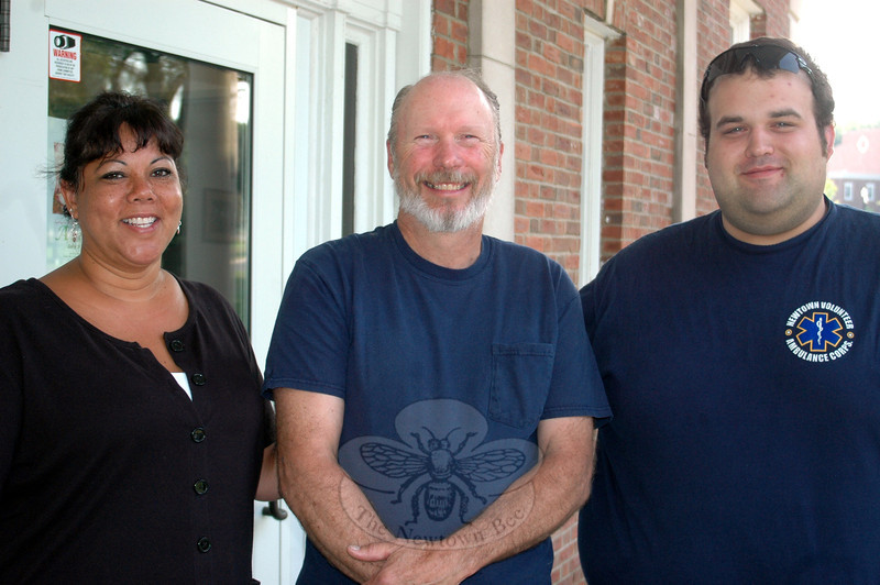 Nearly a week after encountering a wasp nest while cutting his grass, causing a swarm of the insects to sting him multiple times triggering a harrowing medical emergency, Bill Ross, center, finally had a chance to thank Botsford volunteer firefighter Maritza Nezvesky and Paramedic Chris Neary, who were among a team of responders answering the call for help.  (Voket photo)