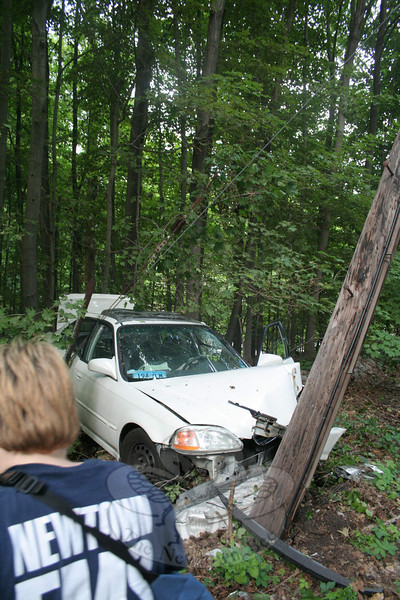 Police said they are investigating a one-vehicle accident that occurred about 5:06 pm July 13 near 23 Chestnut Hill Road. Police said motorist Stephen Sabato, 21, of 18 Washington Avenue was driving a 1996 Honda Civic coupe westward on Chestnut Hill Road, when the vehicle went off the road and then struck a stone wall, a utility pole, and a tree. Kenton Lord, 20, of 35 Cherry Street was a passenger in the auto, police said. Newtown Volunteer Ambulance Corps transported Sabato to Danbury Hospital for treatment of possible injuries, according to police. Sandy Hook volunteer firefighters responded to the accident. The accident required the shattered utility pole to be replaced. Police ask anyone who witnessed the accident to contact investigating Officer William Chapman at the police station at 203-426-5841.  (Hicks photo)