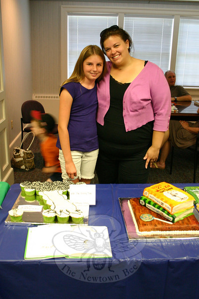 "Veda Broderick, left, and her aunt, Lindsay Broderick, created edible tributes to two of their favorite books. On the table in front of them is their cupcake-based nod to The Giving Tree and on the right is their layered salute to the Diary of A Wimpy Kid book series, the latter of which was bestowed The Silver Spoon Award. (Hicks photo)<br /> <br /> PLEASE NOTE a full gallery of photos from this event, with images of every entry (these are the photos that made up the slide show that accompanied the story about the Edible Book Contest), can be viewed here: <br />  <a href=""http://photos.newtownbee.com/Events/2011-Edible-Books-Contest-at/18154663_43dzvp#1394153855_9F2VNch"">http://photos.newtownbee.com/Events/2011-Edible-Books-Contest-at/18154663_43dzvp#1394153855_9F2VNch</a>"
