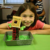 "Rosie Simms smiles proudly with the entry her family created for C.H. Booth Library's Edible Book Contest. The family created the magical portal in Frog Creek, Penn., that is the focus of Mary Pope Osborne's Magic Tree House series.  (Hicks photo)<br /> <br /> PLEASE NOTE a full gallery of photos from this event, with images of every entry (these are the photos that made up the slide show that accompanied the story about the Edible Book Contest), can be viewed here: <br />  <a href=""http://photos.newtownbee.com/Events/2011-Edible-Books-Contest-at/18154663_43dzvp#1394153855_9F2VNch"">http://photos.newtownbee.com/Events/2011-Edible-Books-Contest-at/18154663_43dzvp#1394153855_9F2VNch</a>"