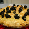 "While they may not be a favorite snack for Paula and Mackenzie Hughes, unsulphured prunes provided a great base for the 24 blackbirds emerging from the duo's pie, which won Judges' Choice in The Edible Book Contest on July 16.  (Hicks photo)<br /> <br /> PLEASE NOTE a full gallery of photos from this event, with images of every entry (these are the photos that made up the slide show that accompanied the story about the Edible Book Contest), can be viewed here: <br />  <a href=""http://photos.newtownbee.com/Events/2011-Edible-Books-Contest-at/18154663_43dzvp#1394153855_9F2VNch"">http://photos.newtownbee.com/Events/2011-Edible-Books-Contest-at/18154663_43dzvp#1394153855_9F2VNch</a>"