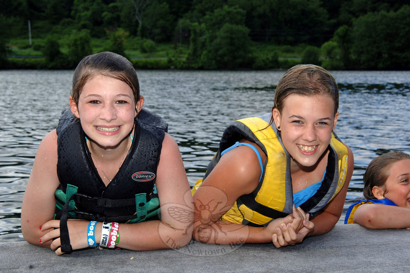 Side-by-side leaning on the dock after jumping in are Lexi Badick and Brittany Kowalski, right.  (Bobowick photo)