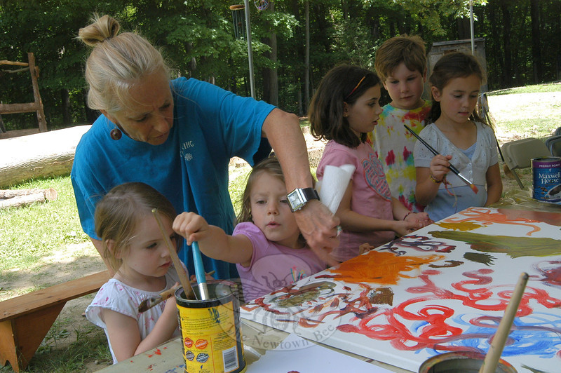 Newtown artist Kathy Grose oversaw students working on a group painting on Thursday, July 14, during a day at Housatonic Valley Waldorf School's Summer Camp.Hallabeck.  (Hallabeck photo)
