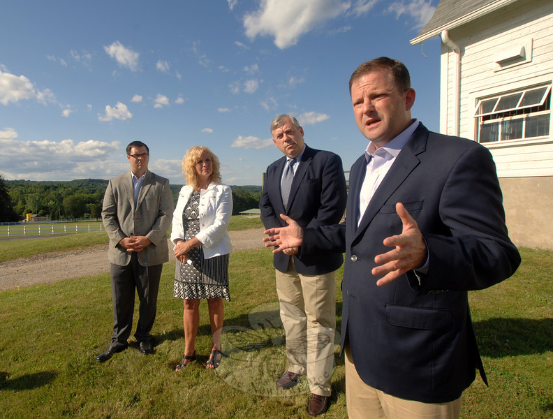 State Representatives Christopher Lyddy and DebraLee Hovey, Selectman Will Rodgers and State Senator John McKinney stand outside The Second Company Governor's Horse Guard facility on July 14, during a hastily arranged press conference after it was learned that the historic organization is again facing the budgetary ax.  (Bobowick photo)