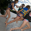 Holding hands and hitting the water last was Elizabeth Wolf, following her friends into the water.  (Bobowick photo)