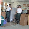 Indoors, 2GHG members loaded office furniture onto hand trucks to move into the storage in anticipation of a move later this month.  (Bobowick photo)