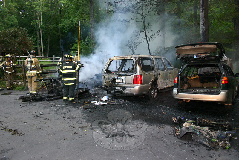 Firefighters from all five local volunteer fire companies responded at 5:48 am Wednesday to the residential property at 16 Rock Ridge Road in Dodgingtown to extinguish an accidental fire that destroyed two motor vehicles and their contents, plus a storage shed and its contents. There were no injuries. The property is across the street from Rock Ridge Country Club.  (Hicks photo)
