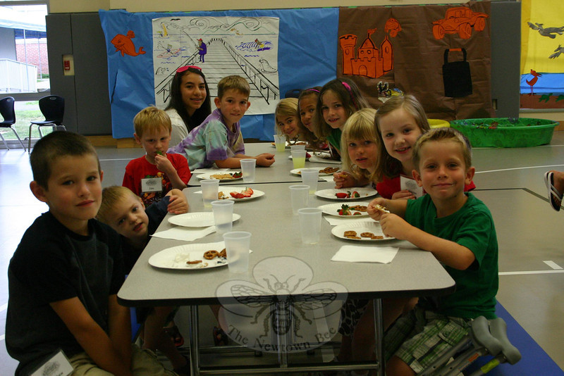 "On Monday morning, July 25, one of the first grade classes started its snack time early. More than 140 students were registered for St Rose's VBS program this year, so each grade had two or three small classes of students. (Hicks photo)<br /> PLEASE NOTE additional photos from St Rose Vacation Bible School were included in a slideshow. All of those photos can be found here:<br />  <a href=""http://newtownbee.smugmug.com/Events/St-Rose-Vacation-Bible-School/18389842_xhM3b2#1417451884_rRrKMhP"">http://newtownbee.smugmug.com/Events/St-Rose-Vacation-Bible-School/18389842_xhM3b2#1417451884_rRrKMhP</a>"