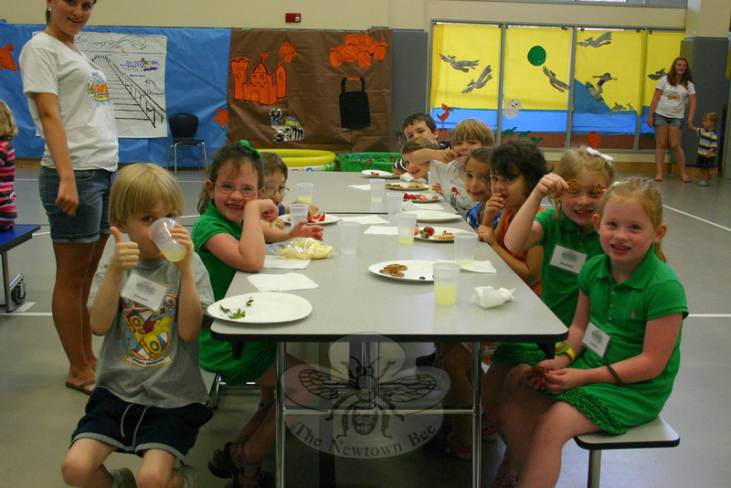 """On Monday morning, July 25, one of the first grade classes started its snack time early. More than 140 students were registered for St Rose's VBS program this year, so each grade had two or three small classes of students. (Hicks photo)<br /> PLEASE NOTE additional photos from St Rose Vacation Bible School were included in a slideshow. All of those photos can be found here:<br />  <a href=""""http://newtownbee.smugmug.com/Events/St-Rose-Vacation-Bible-School/18389842_xhM3b2#1417451884_rRrKMhP"""">http://newtownbee.smugmug.com/Events/St-Rose-Vacation-Bible-School/18389842_xhM3b2#1417451884_rRrKMhP</a>"""