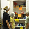 From left, FAITH Food Pantry volunteers Anna Ferris, Ange Zakhar, and Barbara Gates stare in dismay at the nearly empty cupboards in the St John's Episcopal Church emergency food pantry. Donations are down this summer and demand is up, creating a crisis for volunteers and shoppers.  (Crevier photo)