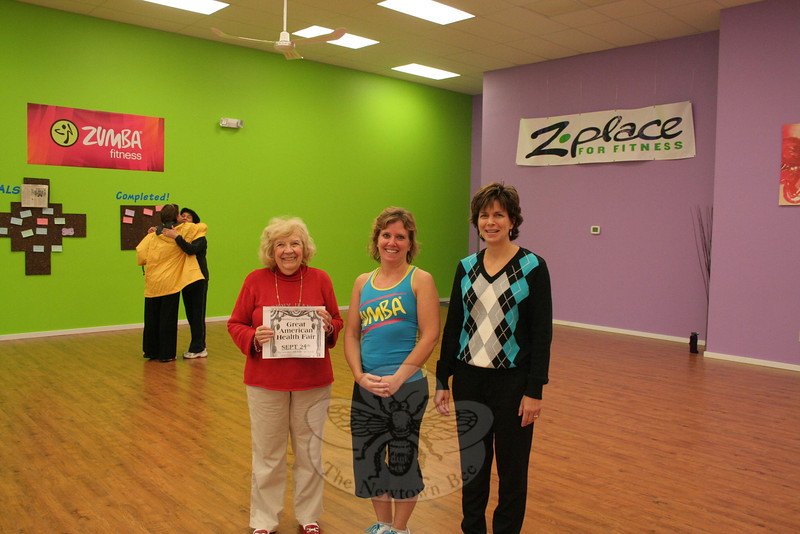 Tammy DeFelice, center, the owner of Z Place For Fitness in Newtown, will bring Zumba to The Great American Health Fair this year. Mrs DeFelice is among the new additions to this year's event, which returns to Newtown Middle School Saturday, September 24. With Mrs DeFelice are two of the event's organizers, Mae Schmidle, left, and Dr Della Schmid.  (Hicks photo)