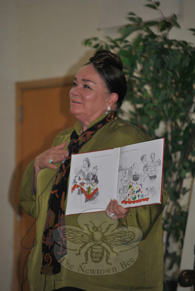 Her heartfelt love for family is apparent as author Patricia Polacco retells the story of The Keeping Quilt to Sandy Hook School students, Thursday afternoon, September 15. The Keeping Quilt is one of the most popular books the author of 80 has published, she said.  (Crevier photo)