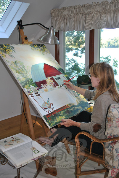 """Artist Susan McLaughlin adds finishing touches to """"Mock Turtle Soup,"""" one of 49 paintings and drawings she will exhibit at The Good News Café in Woodbury, September 27 to November 29. The public is invited to meet the artist and view the collection during an opening reception at the café on Sunday, October 2.  (Crevier photo)"""