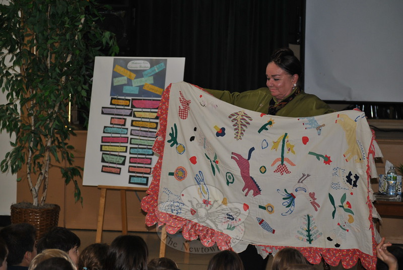 Author Patricia Polacco displays the family heirloom quilt on which her book, The Keeping Quilt, is based during a recent visit to Sandy Hook School. (Crevier photo)