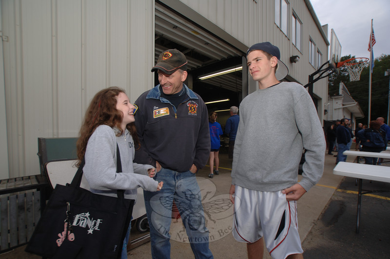 Jim Swenson and his son and daughter Nick and Rachel share a joke as they wait for the band to play.  (Bobowick photo)