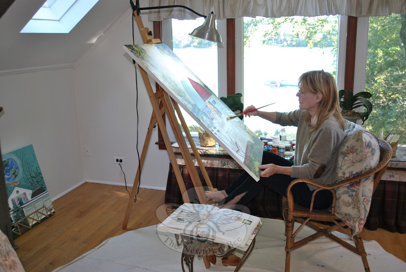 Pouring in through skylights and reflected off of the lake outside her home, Ms McLaughlin's upstairs studio is filled with natural light. The setting allows her to feel a part of the nature all around her that is so important to her art work.  (Crevier photo)