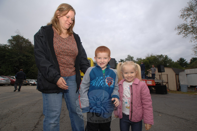 Siblings Connor and Kayla Sinapi and their mother Jen wait for the band Fast Ricky to play during the Botsford Oktoberfest on September 16.  (Bobowick photo)